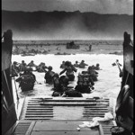 "WWII: Europe: France; ""Into the Jaws of Death — U.S. Troops wading through water and Nazi gunfire"", circa 1944-06-06."