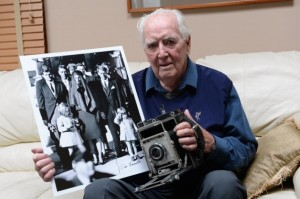 Dan Farrell, of Long Island, holds another historic photo taken from a different angle that he took for the New York Daily News