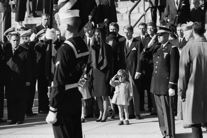 Image result for jfk laid to rest at arlington cemetery  jackie lit the eternal flame