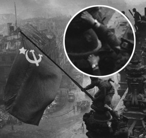 Red army soldiers raising the soviet flag on the roof of the reichstag with two Watches