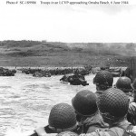 Troops-watch-activity-ashore-on-Omaha-Beach