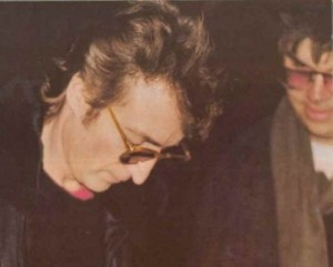 The last photo of Lennon taken with Chapman in the background.  By Paul Goresh