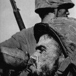 American Soldier Drinking From A Canteen