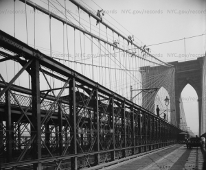Brooklyn Bridge showing system of painting bridge on cables on September 22, 1914