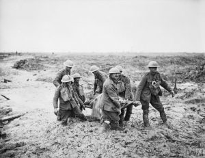 THE BATTLE OF PASSCHENDAELE, JULY-NOVEMBER 1917 (Q 5935) Battle of Pilckem Ridge. Stretcher bearers struggle in mud up to their knees to carry a wounded man to safety near Boesinghe, 1 August 1917.