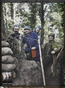 Colour photo of men in a trench